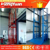 China 300kg-3000kg floor to upstairs guide rail chain hydraulic goods lifting platform on sale