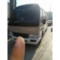 China 1HZ Diesel Engine LHD Used Coaster Bus 2x4 Drive 29 Seats Equipped A/C on sale