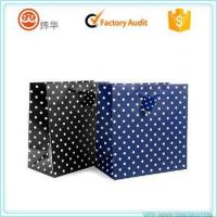 Wholesale 210gsm luxury gift paper bag with fancy dots pattern printed from china suppliers